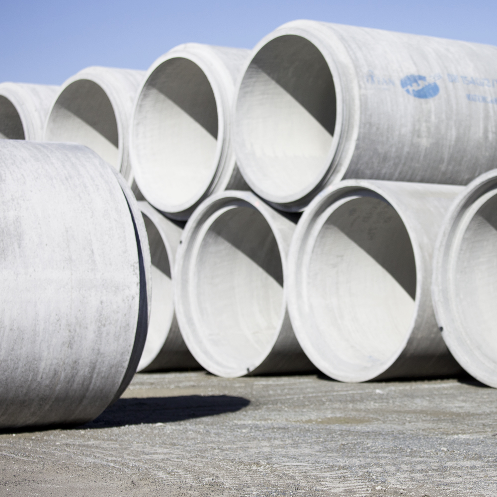 Humes Large diameter Spun concrete pipe stacked