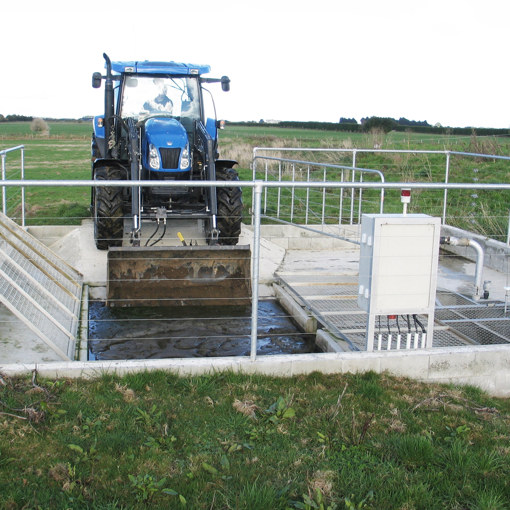 Tracta entering Humes concrete precast stonetrap on a farm